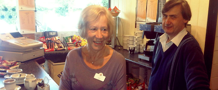 two volunteers serving in the cafe bar area