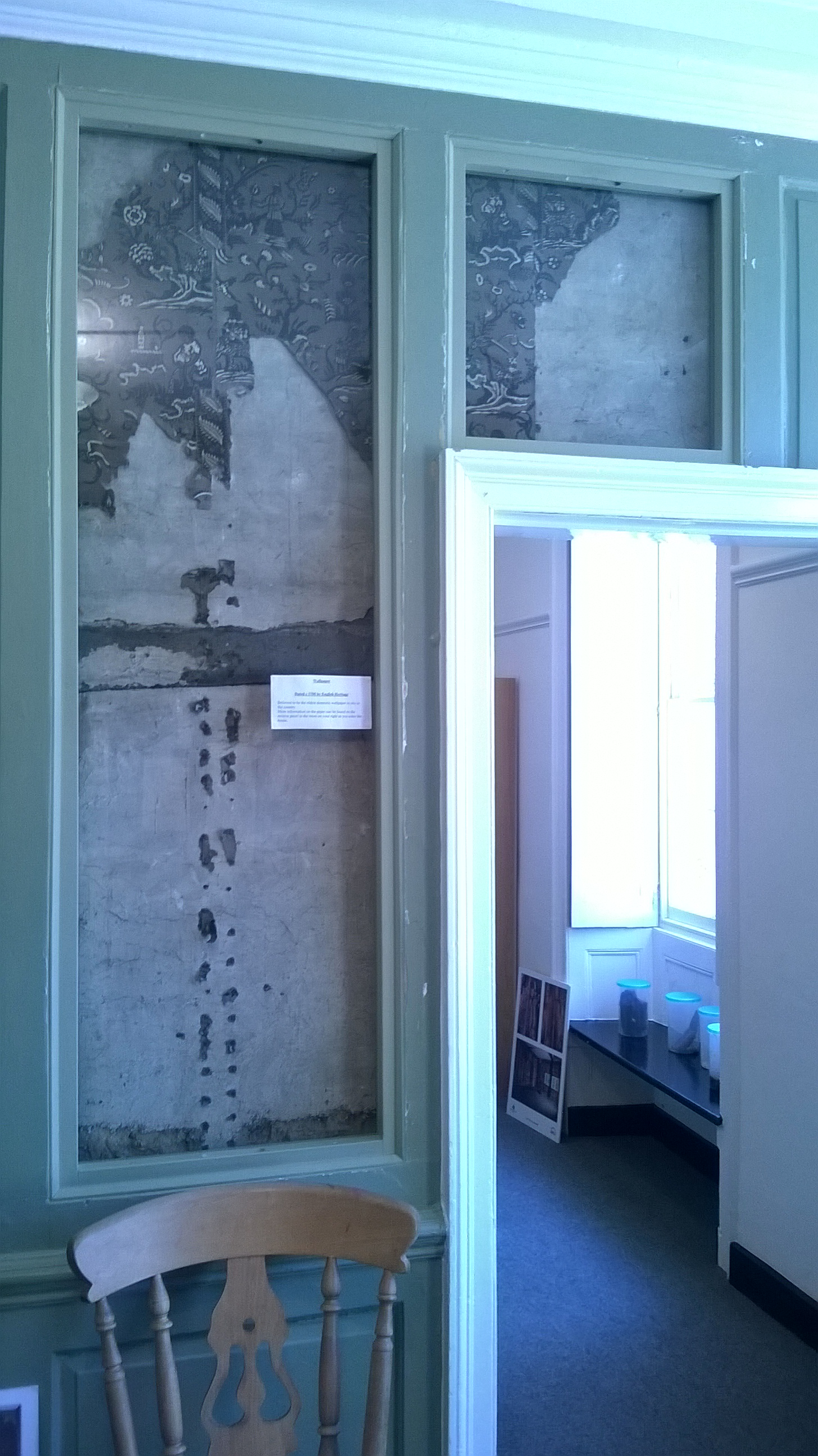 Remains of 18th century wallpaper displayed in Manor Farm House Entrance Hall