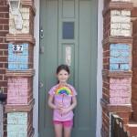 Liza Grinstead - daughter in doorway