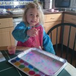 Daughter Emilia - using toy utensils to paint