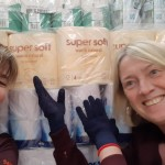 Jane and sister Cindy with toilet rolls